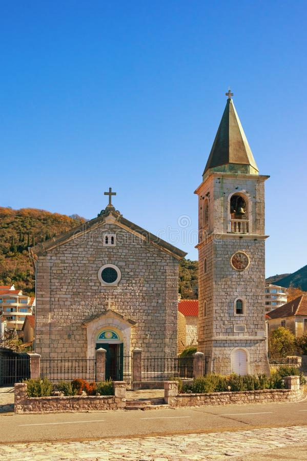 Village church in Mediterranean. Montenegro, Tivat. View of Catholic Church of Saint Roch in Donja Lastva village. On sunny winter day stock photos