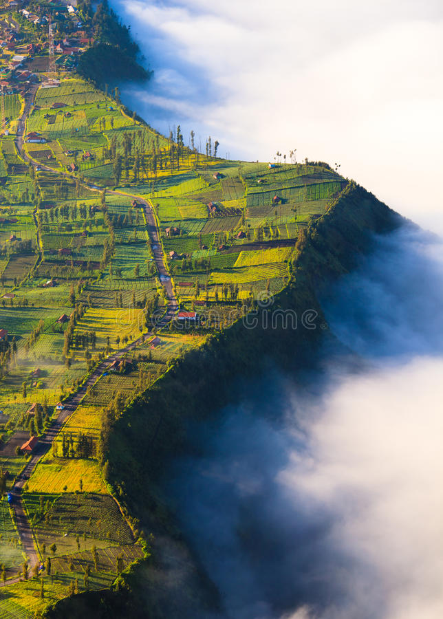 Village and Cliff at Bromo Volcano in Tengger Semeru, Java, Indonesia. Village and Cliff at Bromo Volcano in Tengger Semeru national park, Java, Indonesia stock photo