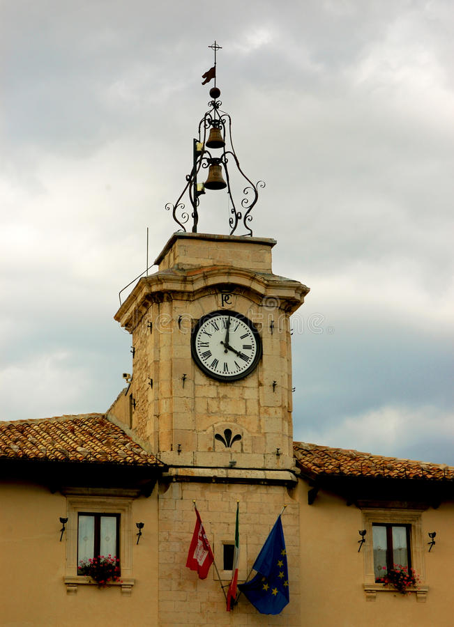 The village clock. Tower clock in Pescocostanzo, Abruzzo, Italy royalty free stock photo