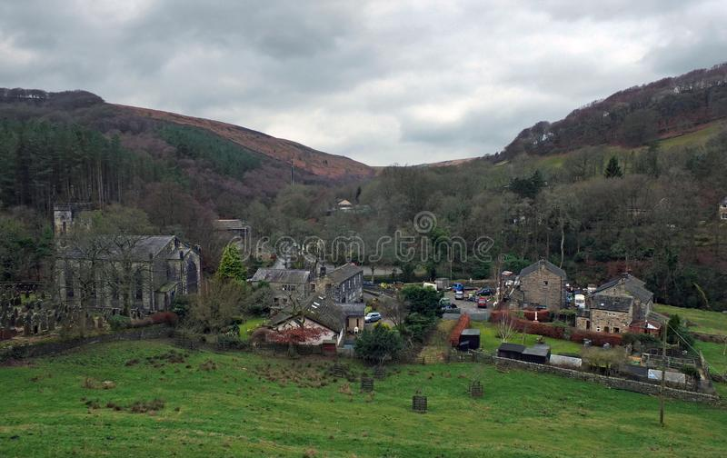 The village of cragg vale in calderdale west yorkshire showing the church and houses between high pennine hills.  royalty free stock photo