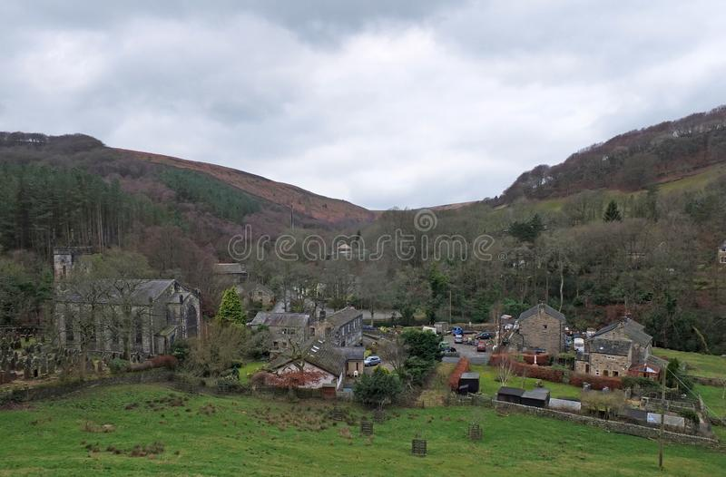The village of cragg vale in calderdale west yorkshire showing the church and houses between high pennine hills.  royalty free stock photography