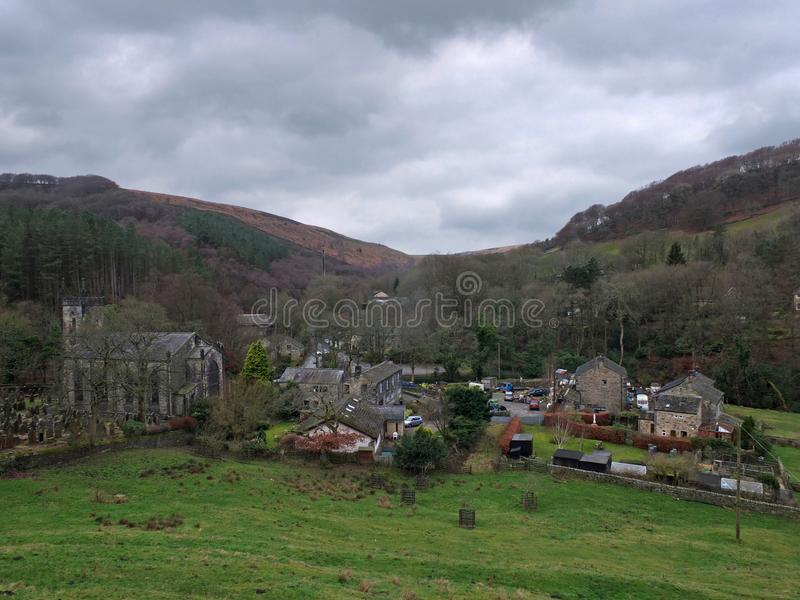 Village of cragg vale in calderdale west yorkshire showing the church and houses between high pennine hills. The village of cragg vale in calderdale west royalty free stock image