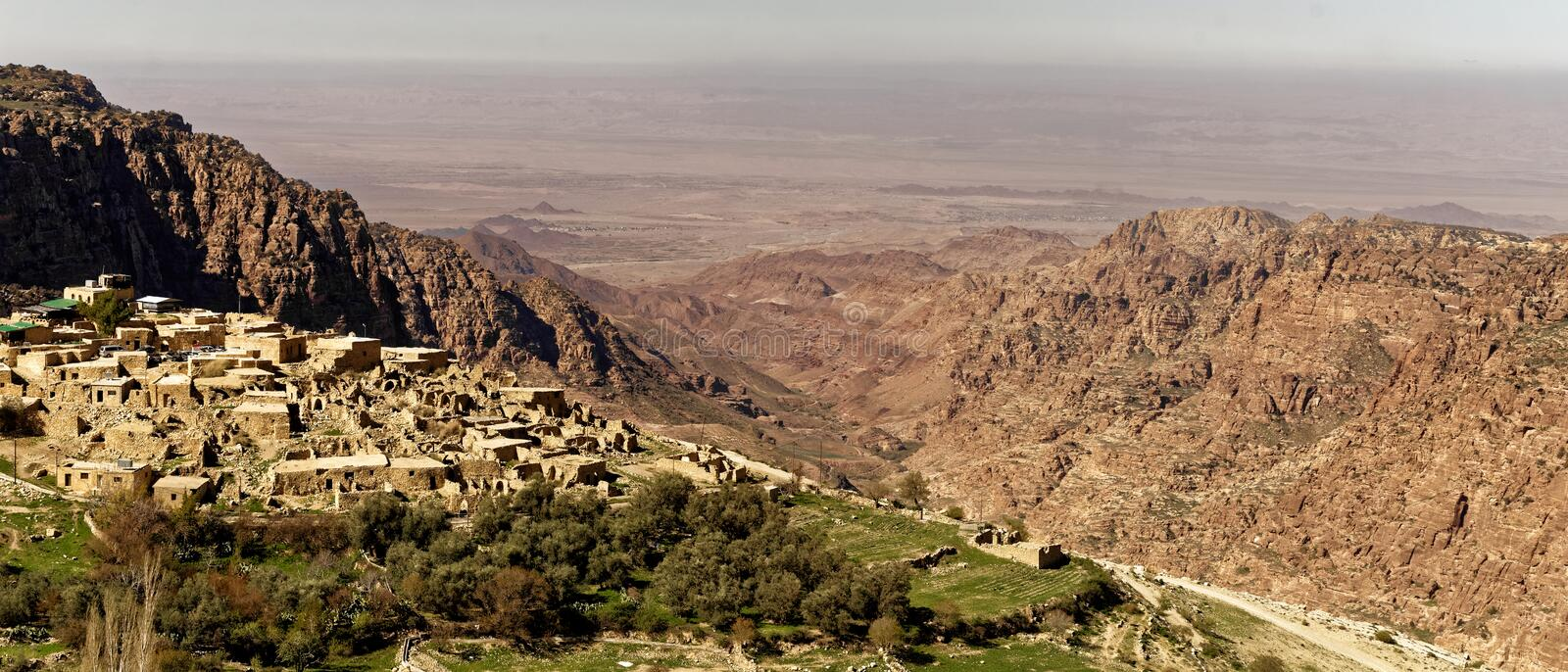 The village of Dana on the edge of the Dana Reserve, a deep valley cut in the south-western mountainous region of the Kingdom of J. Ordan, panoramic view, middle stock photography