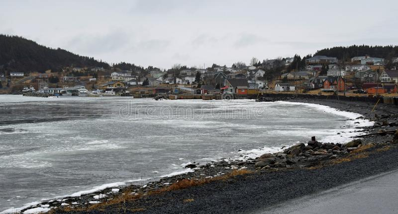 Village of Dildo NL early Spring. View across the bay towards the  landscapes along the Baccalieu trail, Avalon Peninsula Newfoundland Canada stock image