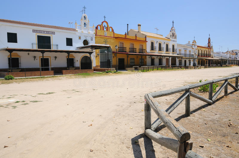 The village of El Rocio, near Huelva, Spain. Typical houses in El Rocio, near Huelva, Spain, used by Confraternities during the annual historic pilgrimage in stock photo