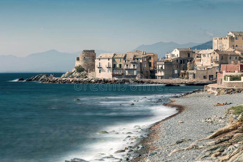 Village and shingle beach of Erbalunga in Corsica royalty free stock images