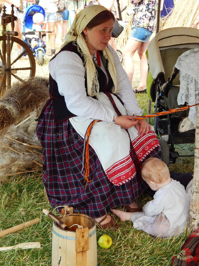 A village family at the fair. A festival of historical reenactment Times and epochs in Moscow in June, 2014