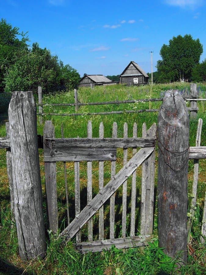 Village fence door royalty free stock photo