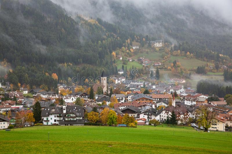 village in fog in late autumn, Castelrotto, Dolomites, Italy royalty free stock photos