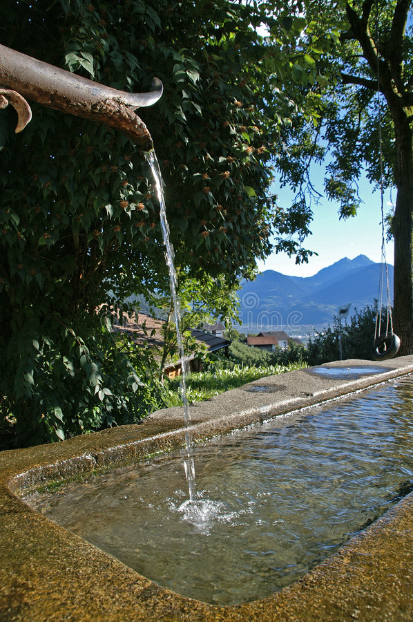 village fountain stock photos