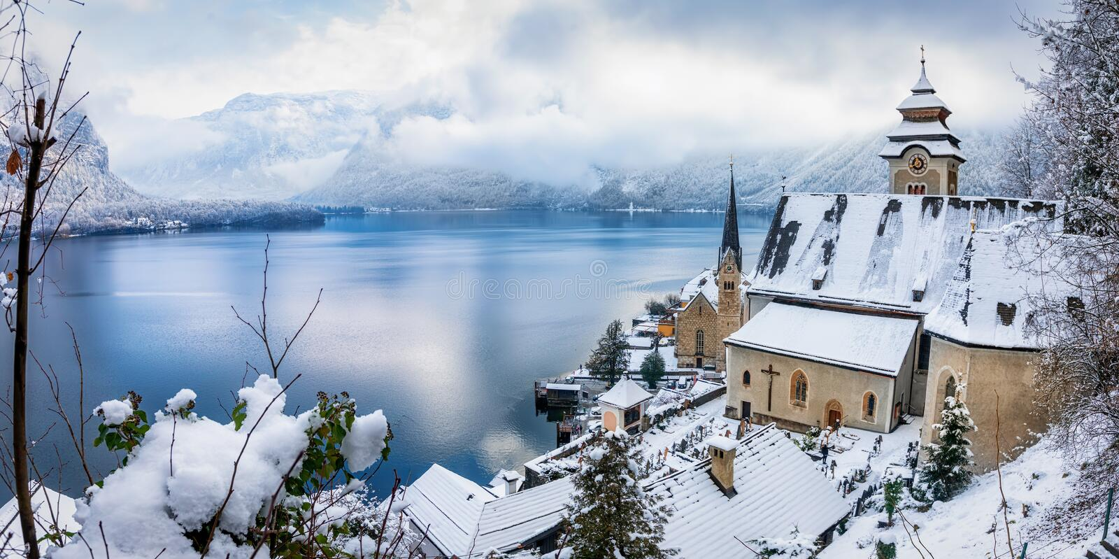 The village of Hallstatt in the Austrian Alps with lots of snow. Panoramic view of the small village of Hallstatt in the Austrian Alps during a cold winter stock photo
