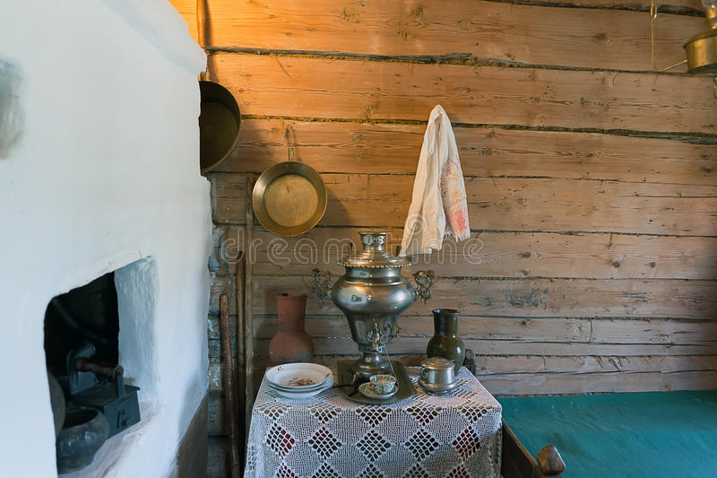 Village house interior. Furnace bed and a samovar on the bedside table royalty free stock photos