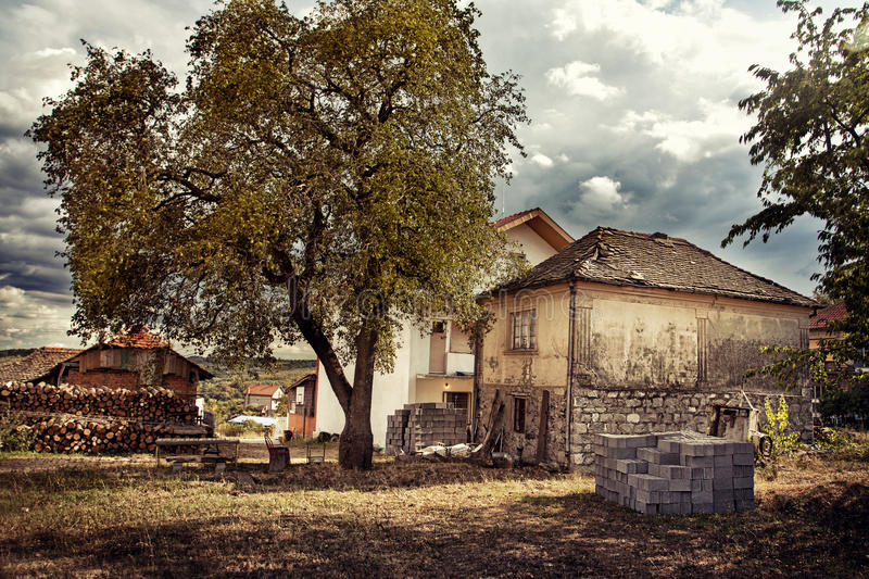 Download Village House With Tree Royalty Free Stock Image - Image: 27106366