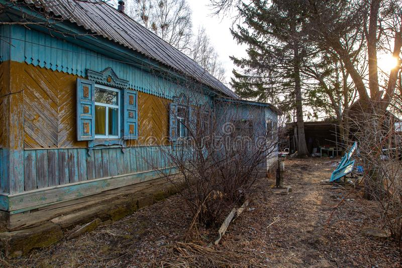 Village hut without a fence. Russian village. Old residential wooden house in a Russian village in spring. Village hut without a fence stock photo