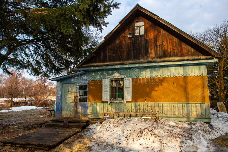 Village hut without a fence. Russian village. Old residential wooden house in a Russian village in spring. Village hut without a fence stock photos