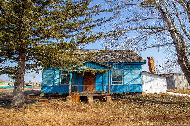 Village hut without a fence. Russian village. Old residential wooden house in a Russian village in spring. Village hut without a fence stock photography