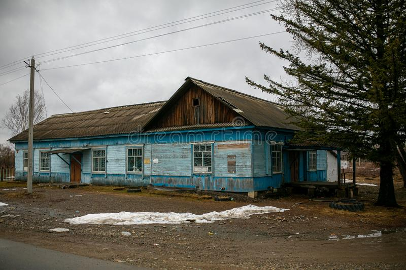 Village hut without a fence. Russian village. Old residential wooden house in a Russian village in spring. Village hut without a fence royalty free stock photo