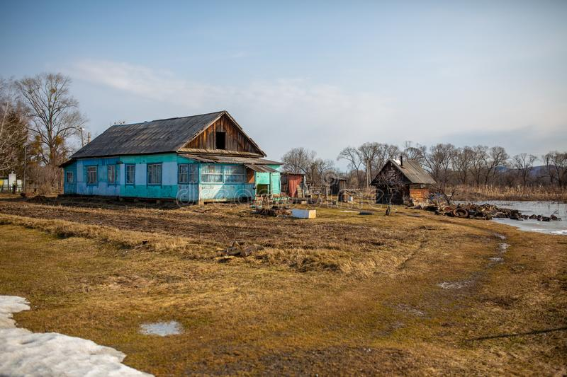 Village hut without a fence. Russian village. Old residential wooden house in a Russian village in spring. Village hut without a fence royalty free stock image