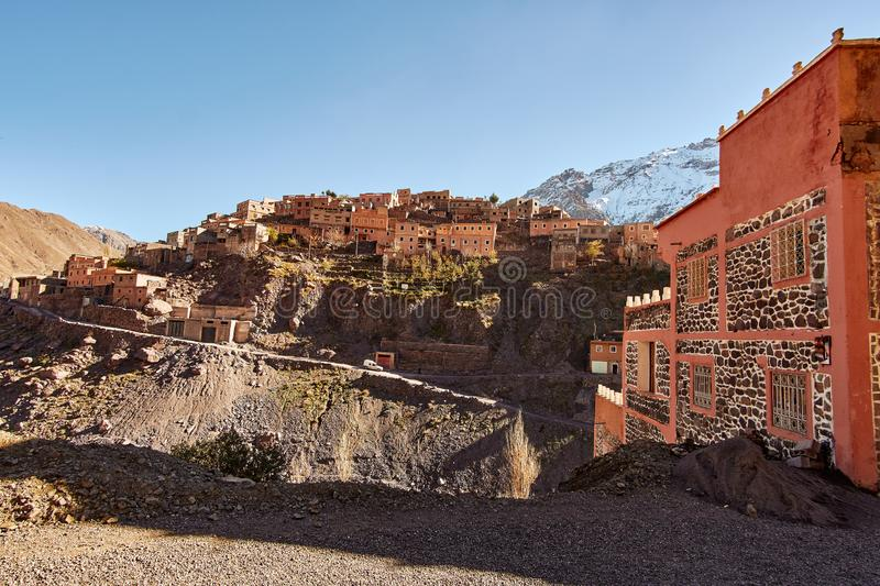 Traditional Moroccan mountain village in High Atlas mountains stock images