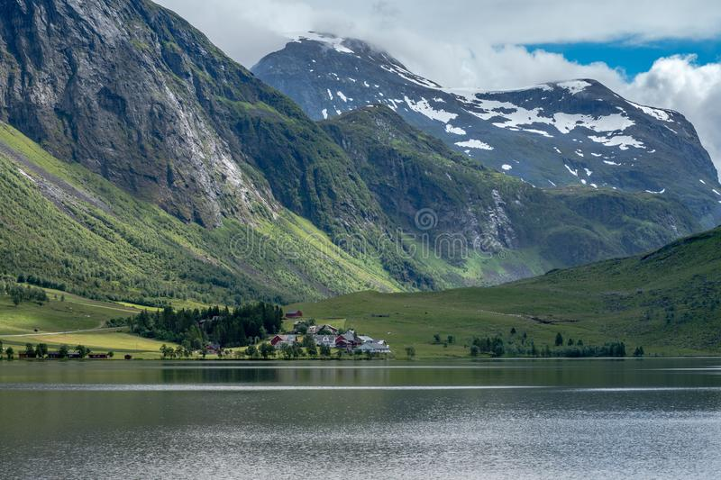Village by the lake in a mountain valley in Norway stock image