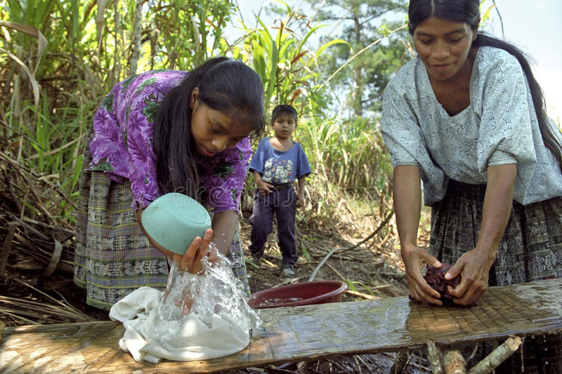 Village life Indian mother and daughter wash laundry. Guatemala, department Alto Verapaz, village San Pablo Purulha: in the mountain region, highlands, around stock photo