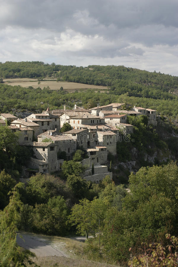 A village in the Luberon, France. Above a small gorge in open countryside under a cloudy sky royalty free stock image