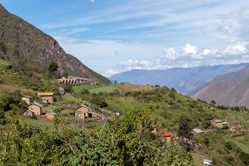 Village of Marampata at green Peruvian mountains, Apurimac river valley with bkue sky, Peru. Village of Marampata at green Peruvian Andes mountains. The tiny royalty free stock photos
