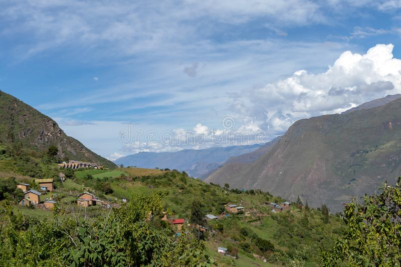 Village of Marampata at green Peruvian mountains, Apurimac river valley with bkue sky, Peru. Village of Marampata at green Peruvian Andes mountains. The tiny stock images