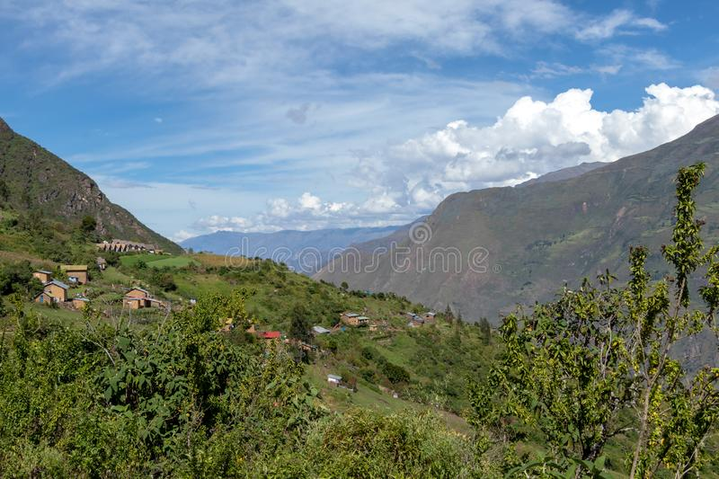 Village of Marampata at green Peruvian mountains, Apurimac river valley with bkue sky, Peru. Village of Marampata at green Peruvian Andes mountains. The tiny stock photo