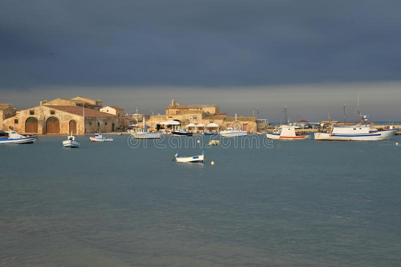 Marzamemi, Sicily, Italy. the old village harbor. Village of Marzamemi, province of Siracusa, Sicily, Italy. The old town harbour royalty free stock photos