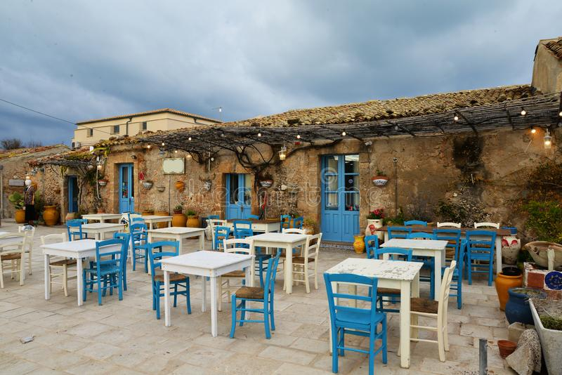 Marzamemi, Sicily, Italy. Old village cafe. Village of Marzamemi, province of Siracusa, Sicily, Italy. The old town square in winter. village cafe and outdoor stock photos