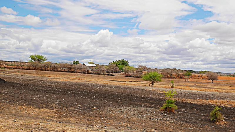 The village of the Masses in Tanzania. Cloudy sky in Tanzania, Africa, to meet adventures, safaris, Tarangiri, Ngorongoro,gray earth, the village of the Masses royalty free stock photography