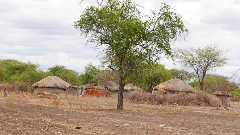 The village of the Masses in Tanzania. Cloudy sky in Tanzania, Africa, to meet adventures, safaris, Tarangiri, Ngorongoro,gray earth, the village of the Masses stock photography