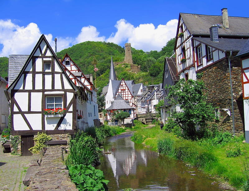 Village of Monreal, Eifel Mountains, Rhineland-Palatinate, Germany. Historic half-timbered houses and castle tower in the romantic village of Monreal along the stock image