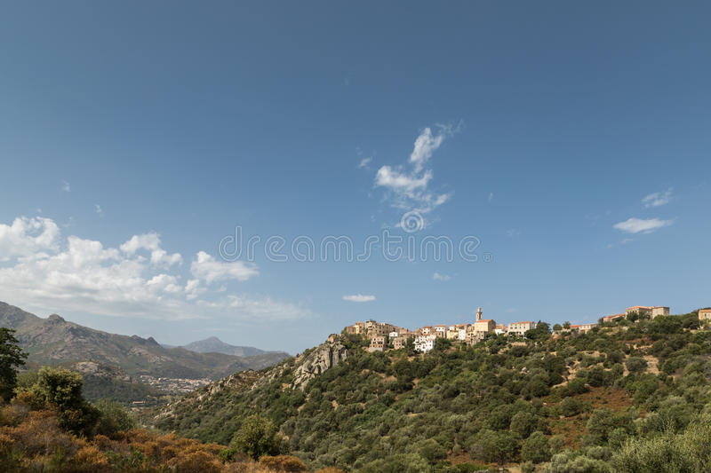 Village of Montemaggiore in the Balagne region of Corsica. Houses and church tower in the mountain village of Montemaggiore in the Balagne region of Corsica with royalty free stock photos