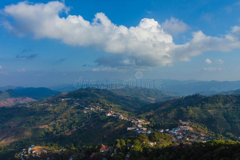 Village on the Mountain, Chaigrai in Thailand. Blue sky and Village in the Mountain, Chiagrai in Thailand royalty free stock images