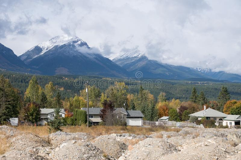 Village and mountain landscape in fall foliage colors, Canada road trip in fall royalty free stock image
