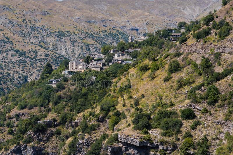 Village in the mountain in National Park of Tzoumerka, Greece Epirus region. Mountain in the clouds royalty free stock photos
