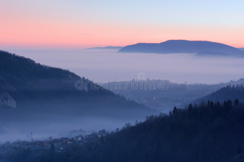 Village between the mountains. Morning view of a village between the mountains stock photos
