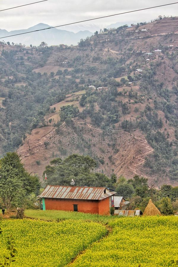 Village in nepal with the view of Himalaya stock photography