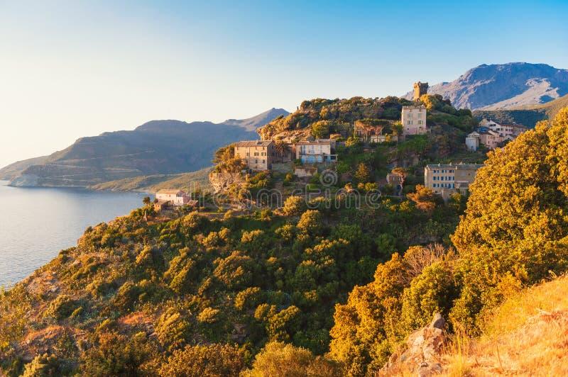 Village of Nonza Corsica. Village of Nonza, Corsica, France at sunset stock photos