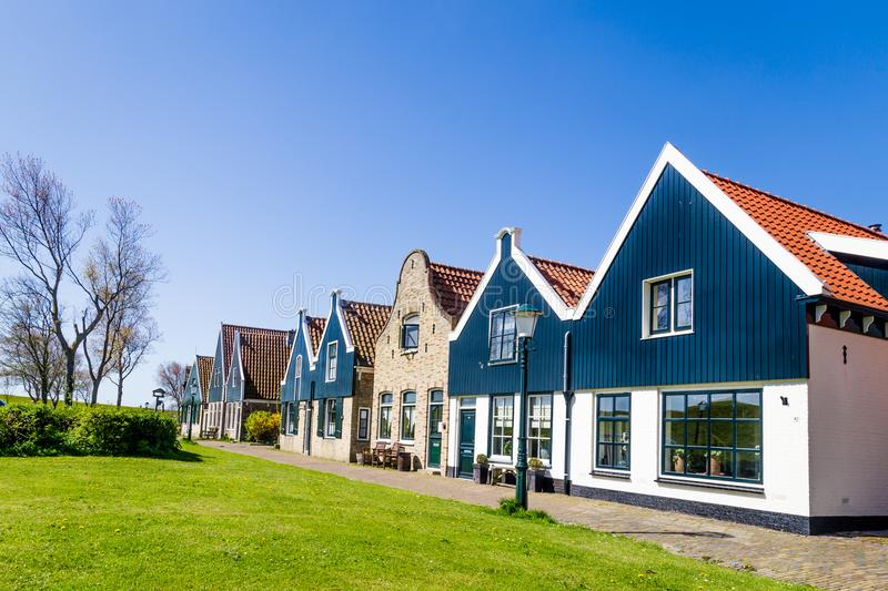 Village Oudeschild on Texel island in the Netherlands. Village Oudeschild with a row of trraditional fisherman houses on Texel island in the Netherlands stock photos
