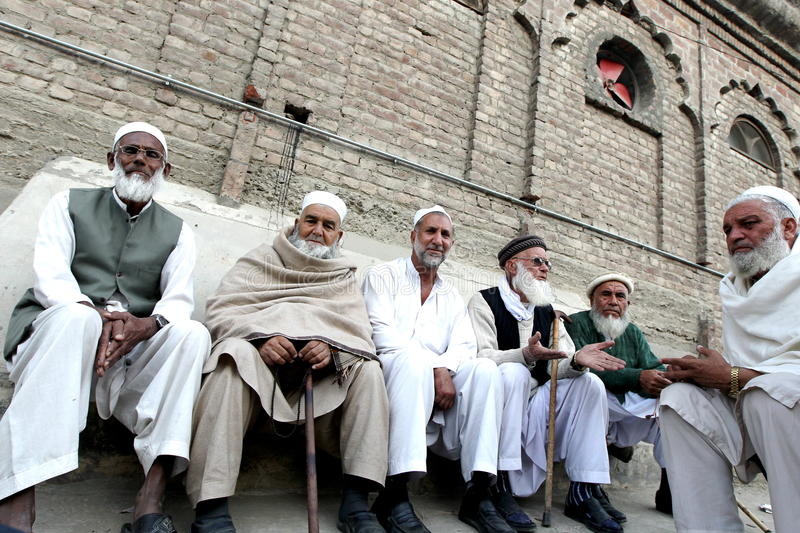 People in Swat Valley Pakistan. Village people gather among themselves in front of the house in the evening in Mingora, the main town of Pakistan's Swat Valley stock photography