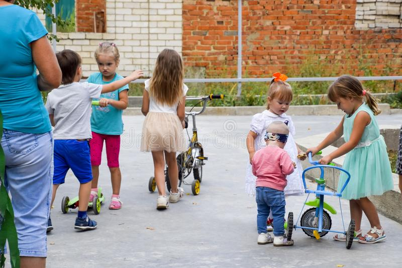 Leisure of preschool children. Animators at a children's party. Acting and developing games for children. royalty free stock image
