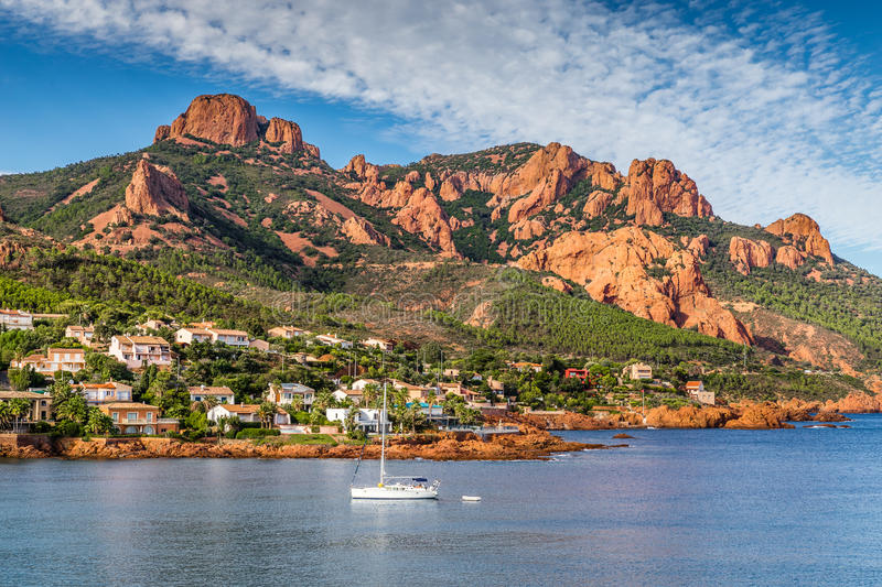 Village Among Red Rocks of Esterel Massif-France. Village And Trees Among Red Rocks of Esterel Massif During Sunny Day-French Riviera, Provence-Alpes, Cote d' royalty free stock photography