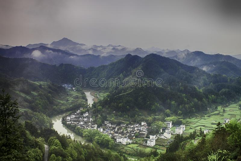 Village in a river valley royalty free stock photo