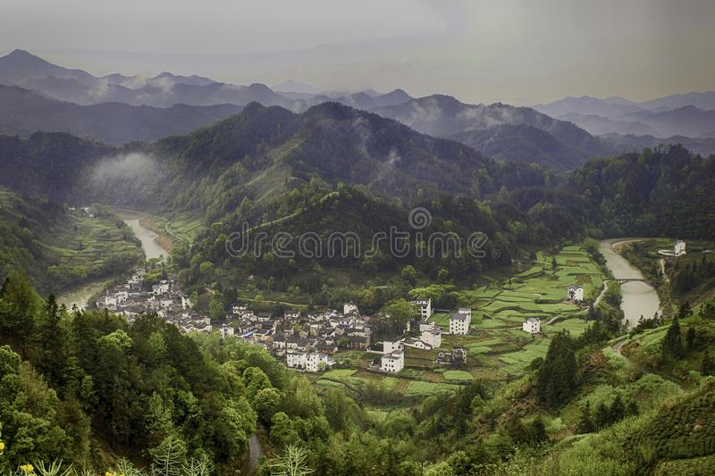 Village in a river valley stock image