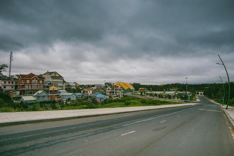 Village Beside Road Under Cloudy Sky stock photography