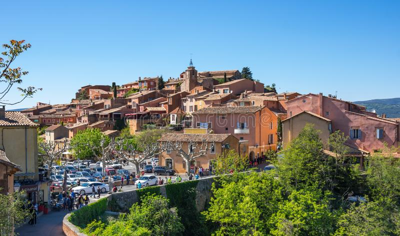 Village of Roussillon in the Provence. ROUSSILLON, FRANCE - APRIL 27, 2016: Panoramic view of medieval village of Roussillon. It ochre village is included in stock photography