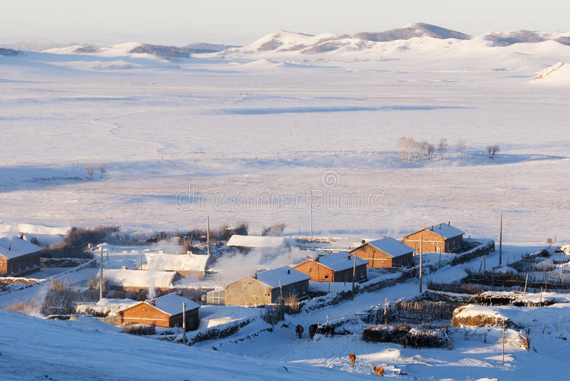 Village in snowy winter stock photography